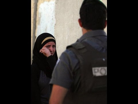 Israeli police attack Palestinian Worshipers in Alaqsa, And Beat Women.