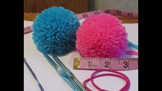 making a 3inch pompom using a folded paper