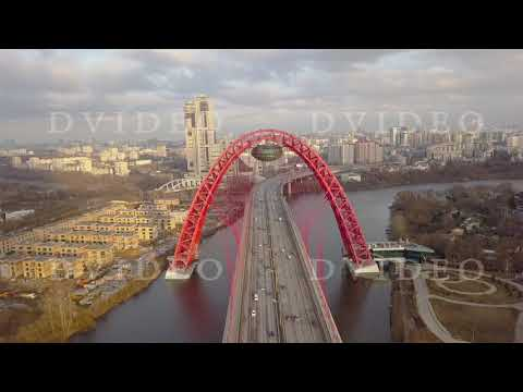 Metal construction of red arch cable stayed Picturesque bridge over Moscow river