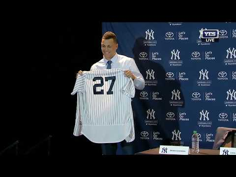 Giancarlo Stanton puts on a Yankees jersey for the first time