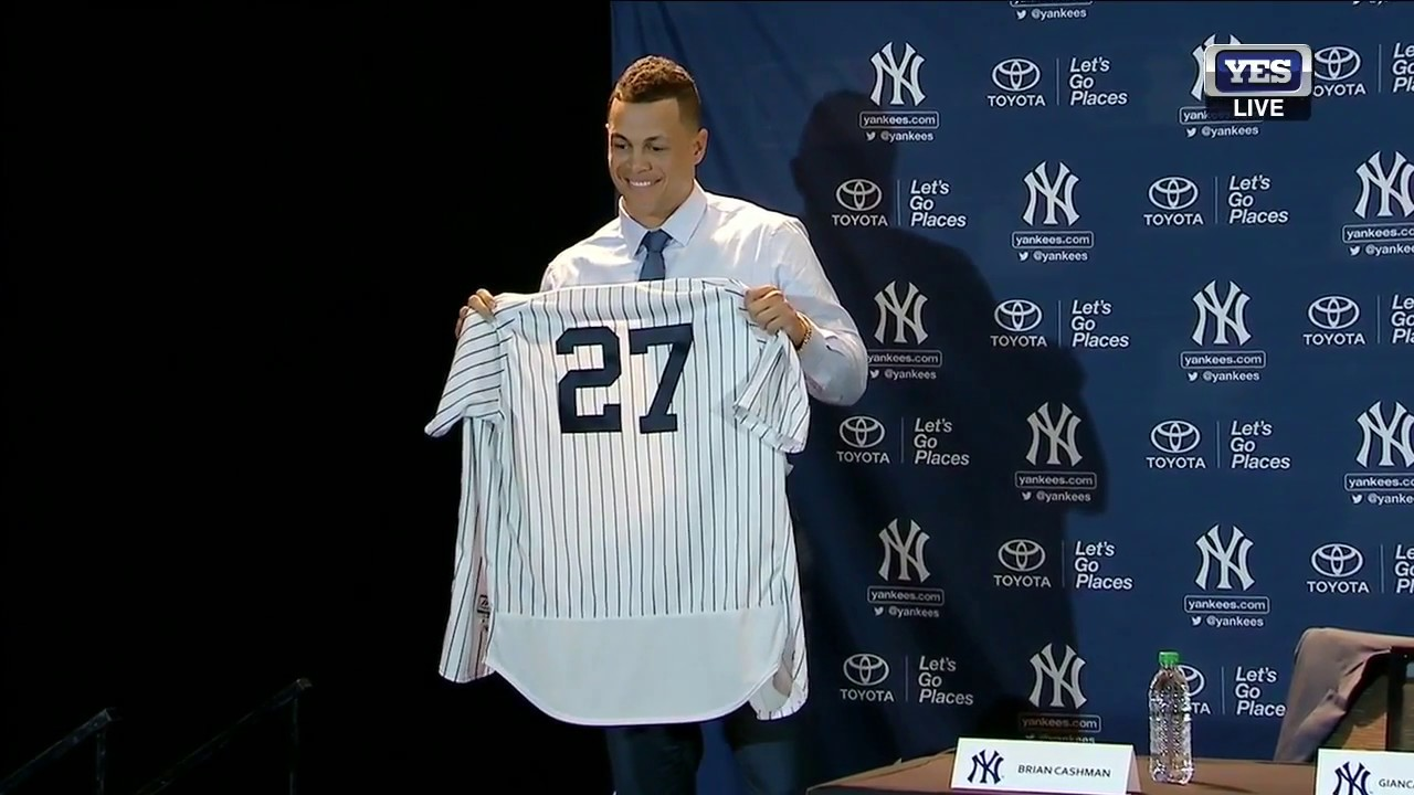 outlet store cf4cf 050d5 Giancarlo Stanton puts on a Yankees jersey for the first time