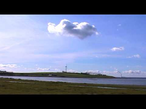 Cardrive along windmills in Denmark  - wind energy power in action - Windräder Windenergie