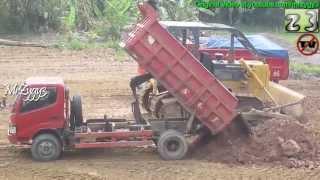 Toyota Dyna Dump Truck Dumping Dirt At Construction Site