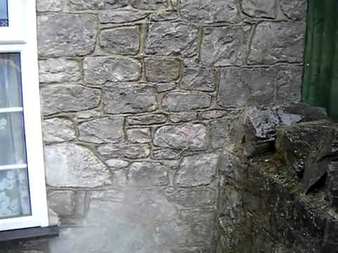 Waterproofing a stone wall 3 of 3