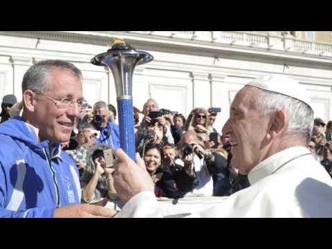 Pope Francis receives the Peace Torch in Rome Oct 12, 2016
