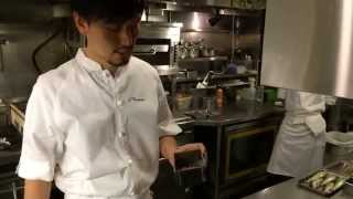 Chef Namae prepares a rare Japanese fish at L'Effervescence in Tokyo