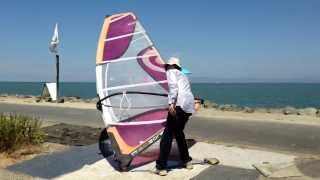 Windsurf dry land duck tack and burner practice featuring Dmitry.