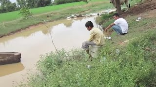 Khmer Fishing at Countryside after the break from Rice planting   Fishing Cambodia at village stream