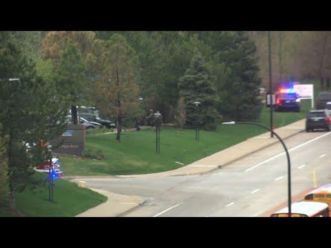 Students take cover as school shooting kills one