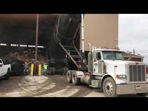 AWESOME 100 Yard Demolition Dump Truck dumping at Transfer station  from Demo job