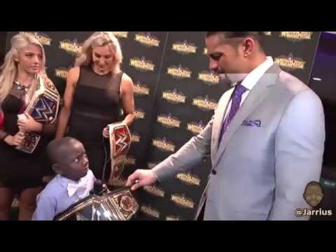 Roman Reigns gives a WWE Championship at a child in the conference of Wrestlemania 34 - WWE André