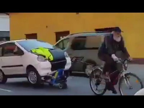 Old man pulls his car with his bike - only in Slovenia
