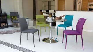 Clear Glass Dining Table and Colourful Chairs
