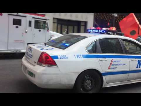 NYPD CRUISER RESPONDING URGENTLY ON BROADWAY IN FINANCIAL DISTRICT AREA OF MANHATTAN, NEW YORK CITY.