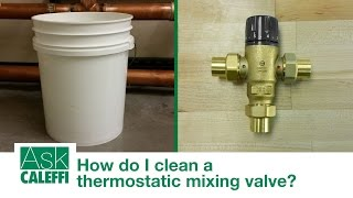How do I clean a thermostatic mixing valve?