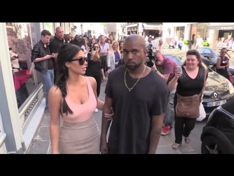 Kanye West Protects Kim Kardashian From Questions Prior to Lavish Wedding | Splash News TV