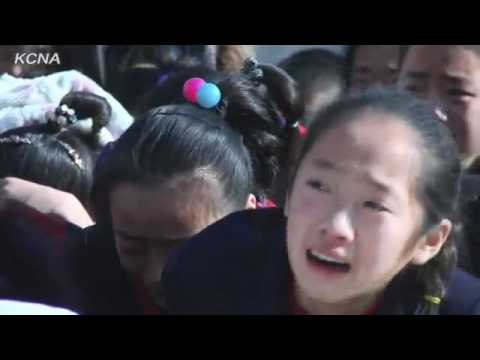 North Koreans (pretending to be) weeping sadly at the death of their