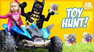 The LEGO Batman Driving Power Wheels Car + Toy Hunt with Pink Supergirl Superheroes IRL | KIDCITY