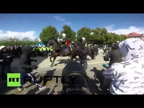 Sweden: Watch Swedish police cavalry charge into protesters