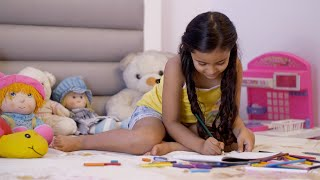 Beautiful little child girl studying and doing creative activities at home