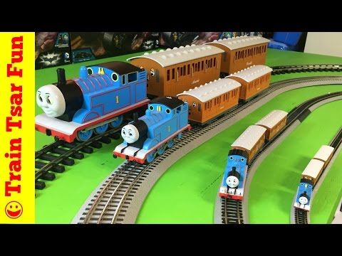 Modelling Railroad Toy Train Track Plans -THOMAS THE TANK ENGINE X4 N, HO, O, G Scale Trains Running on the tracks