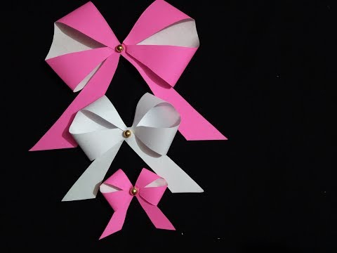 Beautiful and easy paper bow. Paper ribbon for gift decoration .
