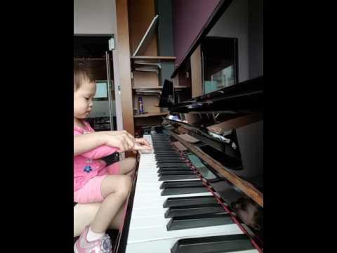 Toddler at piano. Esplanade library piano room