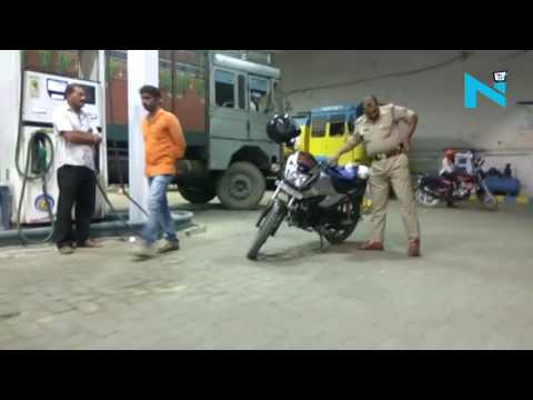 On Cam:  Drunk Police officer in Allahabad creates ruckus