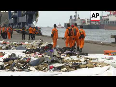 Search teams go through items from crashed jet at Jakarta's port