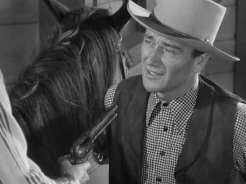 John Wayne Calls Ella Raines Bluff In Tall In The Saddle