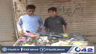 kids playing with toy guns in samanabad celebrating eid day