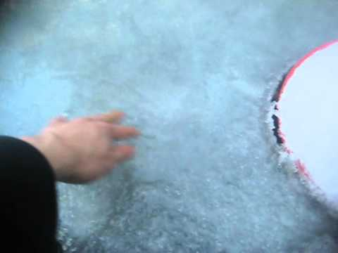 Frozen solid fish pond youtube for Koi pond freezing