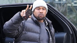 kanye west waves hello to fans in calabasas