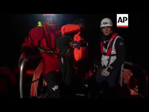 Italian Coast Guard rescues migrants off...
