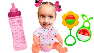 Yastacy found a doll and pretends to be a parent