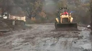 Heavy rain saturates land and triggers mudslides in Southern California