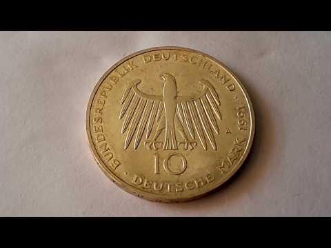 A silver German 10 Deutsche Mark unification coin