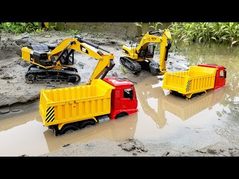 Excavators work under