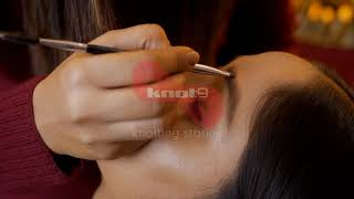 Closeup shot of the beautiful face of an Indian woman getting her eyebrows done