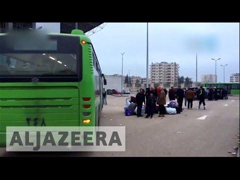 Syrians evacuate Homs' Al Waer district