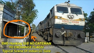 EMD Honks Hard Still no Gateman Came to Exchange Flag! Typical scene of Indian  Railways LC gate!
