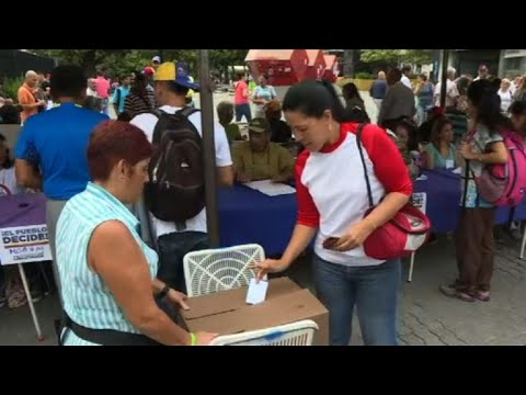 Polls open in Venezuela opposition vote
