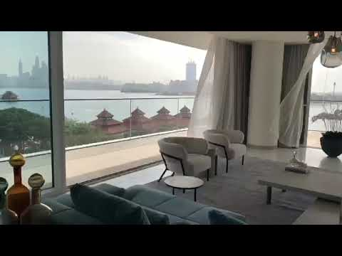 Jumeirah Beach, Dubai, Enjoy roaring sea with Burj Al Arab Hotel seen in  backdrop at Dubai