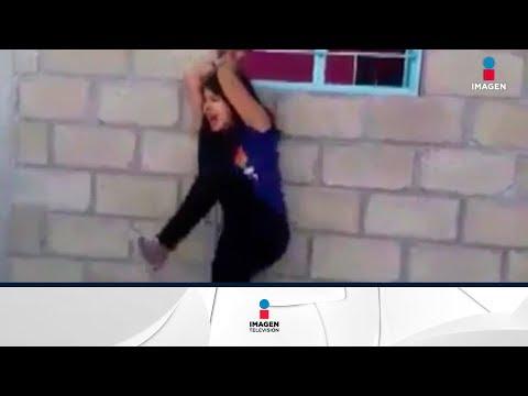 Terrible video de una mujer golpeada 'por infiel' | Noticias con Yuriria Sierra