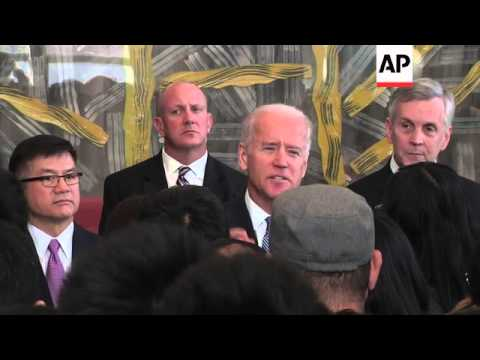 Biden makes surprise visit to Chinese citizens waiting to get US visitor visas