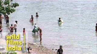 People bathing on the Hooghly river near Howrah Bridge