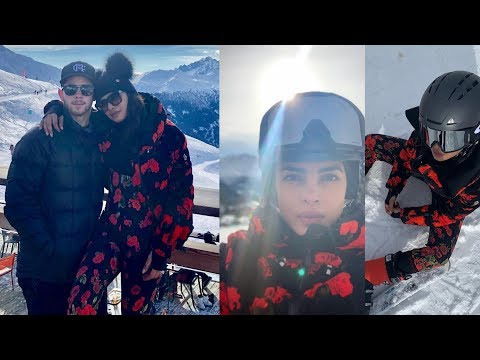 Priyanka Chopra and huby Nick Jonas looking so cute in snow at their honeymoon in Switzeland