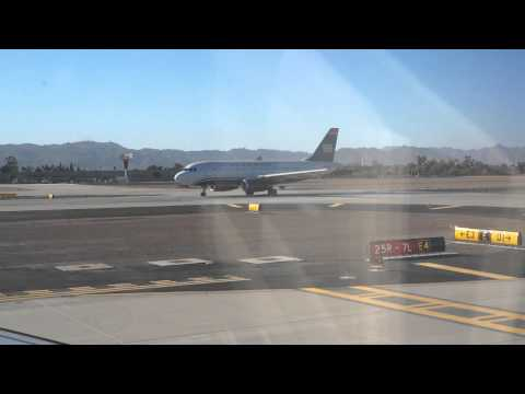 Busy day at Phoenix Sky Harbor International Airport. Airbus A320 takeoff.