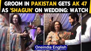 Pakistan: Groom gets an AK 47 as shagun at a marriage, crowd cheers on:Watch the video|Oneindia News
