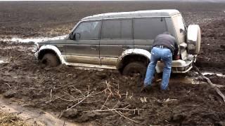 Паджеро болото трактор